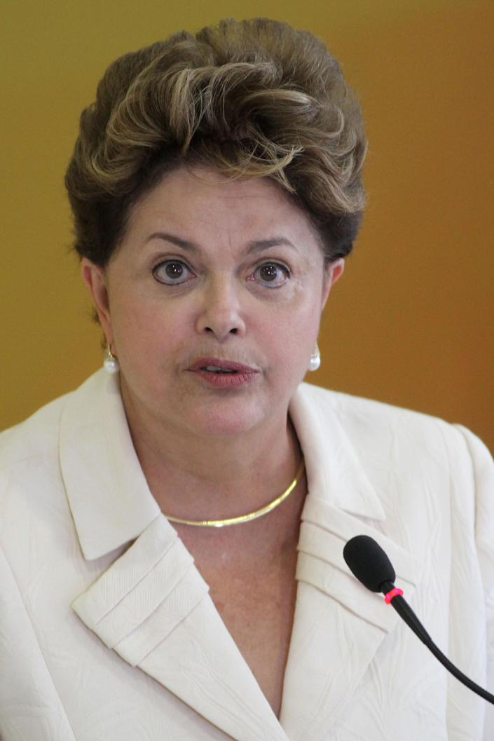 "Brazil's President Dilma Rousseff speaks during a ceremony where she announced an economic stimulus package at the Planalto presidential palace in Brasilia, Brazil, Wednesday, June 27, 2012. The program announced by Rousseff focuses on a wide array of government purchases, from backhoes to motorcycles to military equipment. Rousseff says the government will use stimulus packages ""without restriction"" as Brazil is hit by the crisis in Europe and hobbled by slowing domestic consumer demand. (AP Photo/Eraldo Peres)"