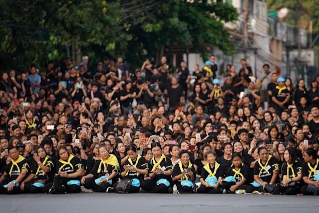 <p>Thai people wait for the last funeral procession of the late Thai King Bhumibol Adulyadej on Oct. 29, 2017 in Bangkok, Thailand. (Photo: Christopher Furlong/Getty Images) </p>