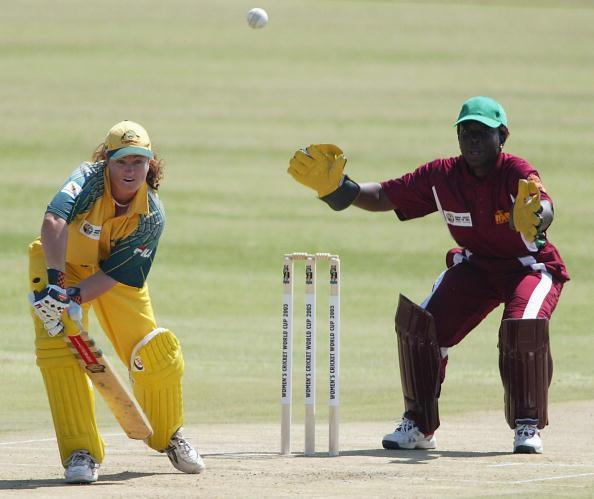 RUSTUNBURG, SOUTH AFRICA - MARCH 26: (TOUCHLINE IMAGES ARE AVAILABLE TO CLIENTS IN THE UK, USA AND AUSTRALIA ONLY) Karen Rolton of Australia plays defensively as Stephanie Power of the West Indies looks on during the IWCC World Cup match between Australia and West Indies at Impala Cricket Club on March 26, 2004 in Rustunburg, South Africa. (Photo by Touchline/Getty Images)