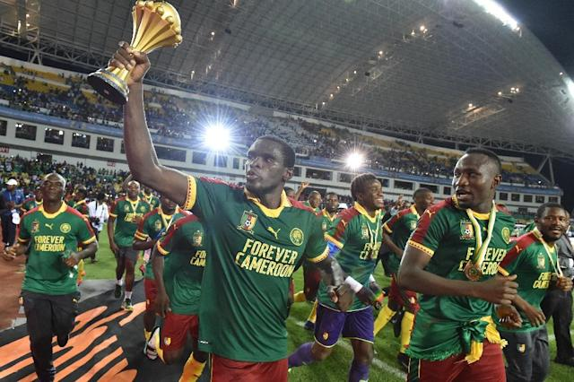 Cameroon's players celebrate beating Egypt 2-1 to win the 2017 Africa Cup of Nations in Libreville on February 5, 2017 (AFP Photo/ISSOUF SANOGO )