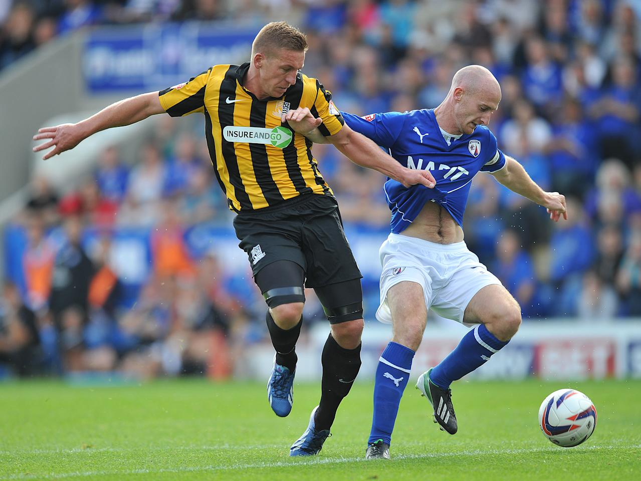 Chesterfield's Drew Talbot and Southend United's Freddy Eastwood battle for the ball during the Sky Bet Football League Two match at the Proact Stadium, Chesterfield.