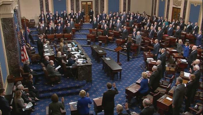 Chief Justice Roberts swears in senators for impeachment trial of President Trump at the U.S. Capitol in Washington