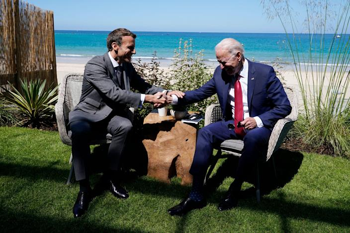 President Joe Biden and French President Emmanuel Macron visit during a bilateral meeting at the G-7 summit, Saturday, June 12, 2021, in Carbis Bay, England.