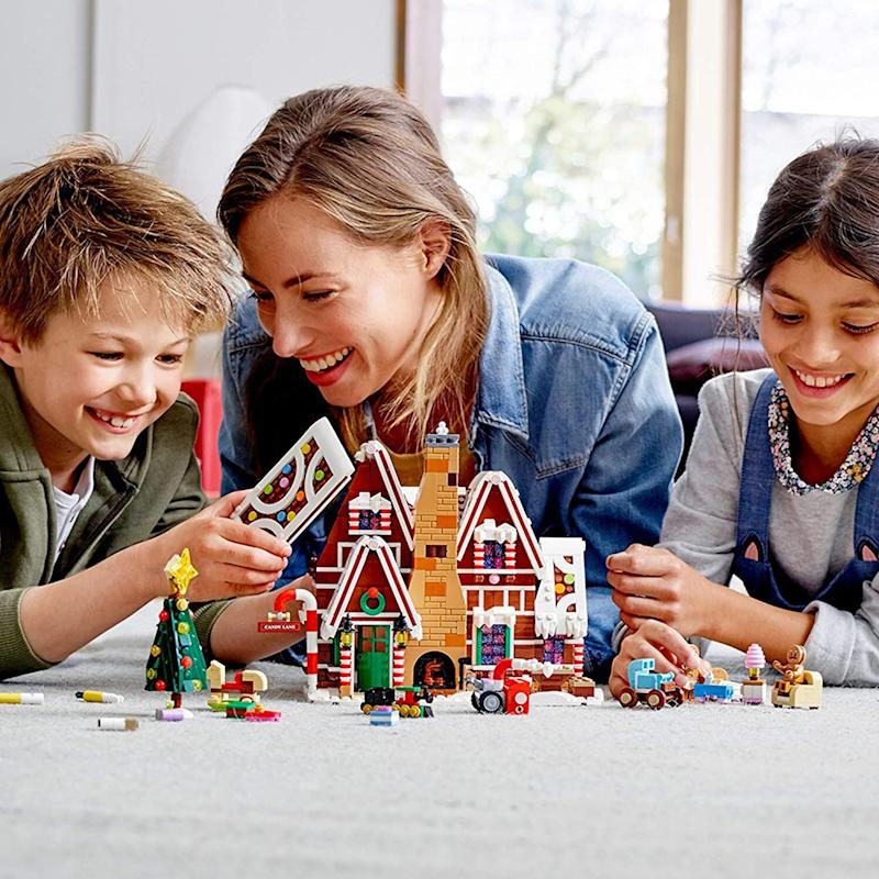 """<a href=""""https://amzn.to/3cuRqEx"""" target=""""_blank"""" rel=""""noopener noreferrer"""">Build a gingerbread house</a>&mdash; without getting frosting all over the kitchen. This Lego kit lets little ones create a house withfrosted roofs and candy cane columns. It comes with a toy train and candy furniture as well. And bonus: It doubles as holiday decor. <a href=""""https://amzn.to/3cuRqEx"""" target=""""_blank"""" rel=""""noopener noreferrer"""">Find it for $100 at Amazon</a>."""