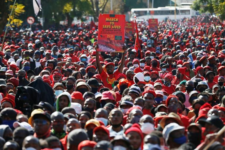 Thousands marched in South Africa to demand regulators speed up approval of new vaccines