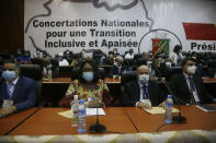 Ambassadors and foreign representations, wait for meeting with Military junta led by Col. Mamady Doumbouya, at the people's palace in Conakry, Guinea Wednesday, Sept. 15, 2021. Guinea's junta is expected to face more pressure to set a timeframe for new elections Tuesday as the military rulers open a four-day series of meetings about the West African nation's future following the president's overthrow in a coup just over a week ago. (AP Photo/Sunday Alamba)