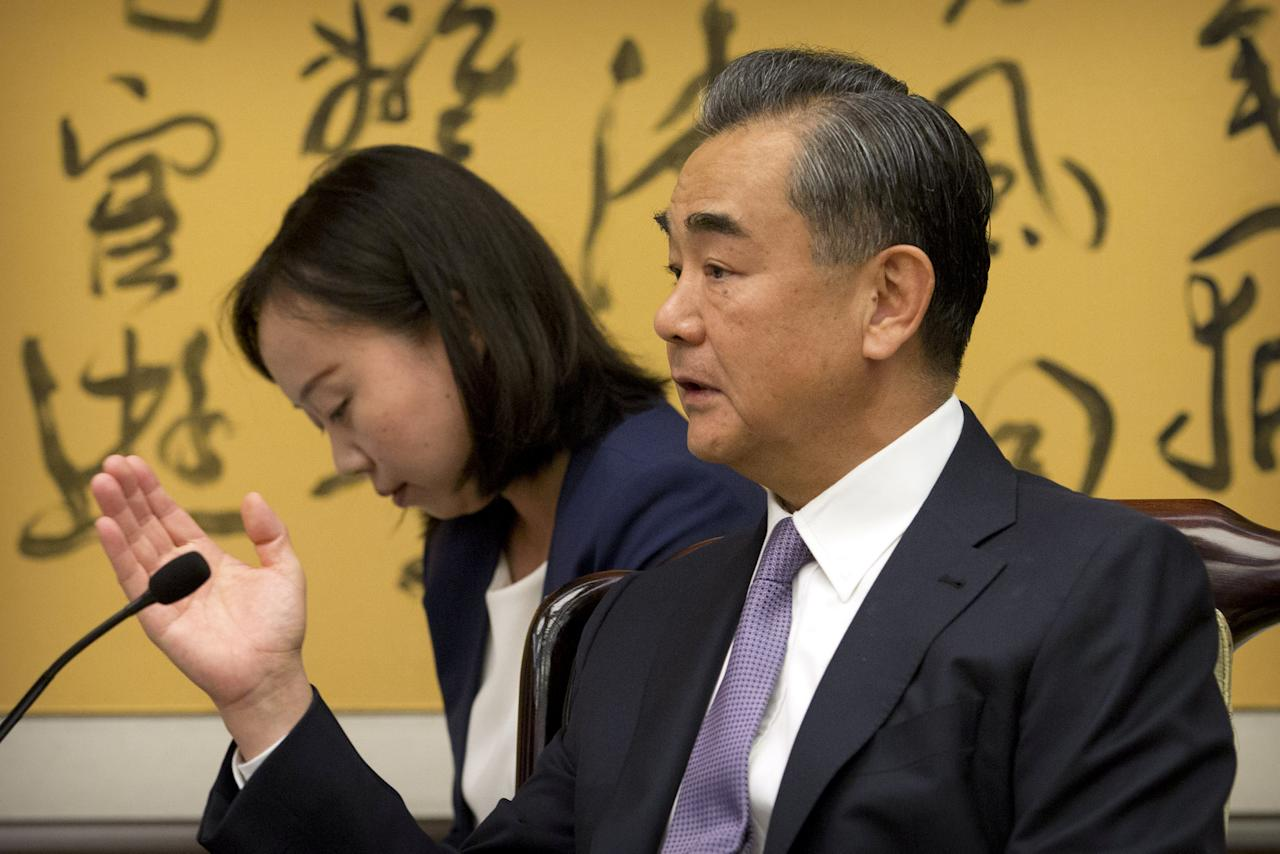 Chinese Foreign Minister Wang Yi speaks during a meeting with Tedros Adhanom Ghebreyesus,  Director General of the World Health Organization (WHO), not shown, at the Ministry of Foreign Affairs in Beijing, Tuesday, July 17, 2018.. Mark Schiefelbein/Pool via Reuters