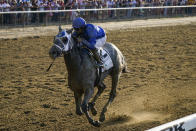 Essential Quality (2), with jockey Luis Saez up, crosses the finish line to win the 153rd running of the Belmont Stakes horse race, Saturday, June 5, 2021, at Belmont Park in Elmont, N.Y. (AP Photo/Seth Wenig)