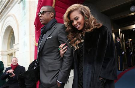 Recording artists Jay-Z and Beyonce arrive at the second presidential inauguration of President Barack Obama on the West Front of the U.S. Capitol in this January 21, 2013 file photo. REUTERS/Win McNamee-POOL