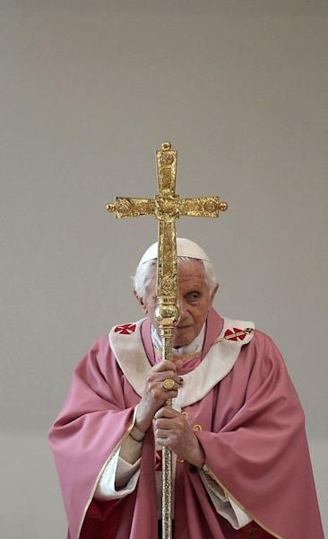 Pope Benedict XVI celebrates a mass at the San Patrizio al Colle Prenestino parish on the outskirts of Rome, on December 16, 2012. The pope says he will resign his post on February 28 because his age prevented him from carrying out his duties, an unprecedented move in the modern history of the Catholic Church