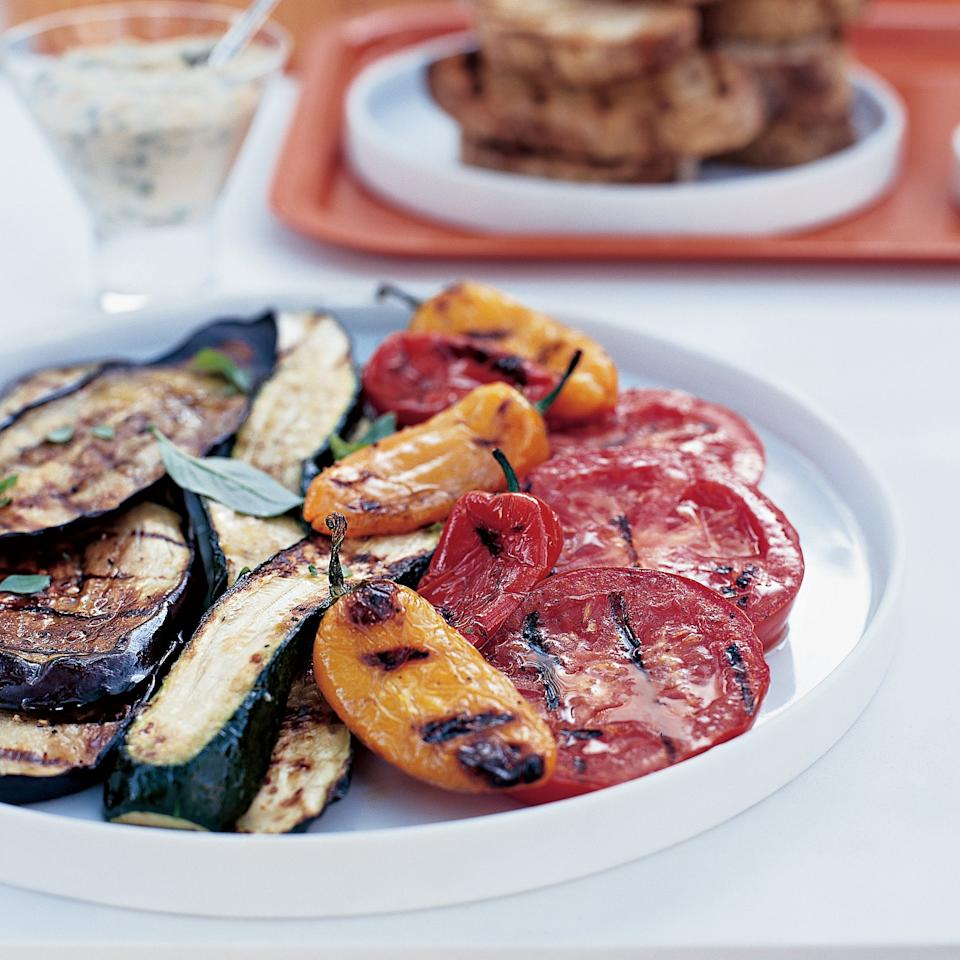 "<p>When Marcia Kiesel grills vegetables, she likes to add unexpected accompaniments, like grilled marinated mini mozzarella balls (called bocconcini) wrapped in anchovy fillets, and garlicky white bean dip. Served with grilled country bread, this antipasto becomes a light main course. The bocconcini should be eaten hot off the grill, while still soft enough to spread on the bread. To prevent sticking, lightly oil the grate before grilling the bocconcini.</p><p><a href=""https://www.foodandwine.com/recipes/grilled-antipasto-garlicky-bean-dip"">GO TO RECIPE</a></p>"