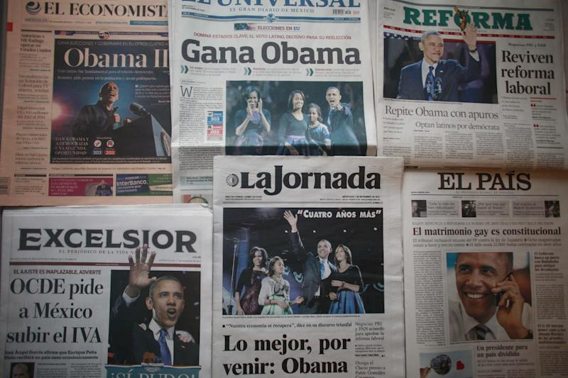 Mexican newspapers carry front page photos and stories about the U.S. presidential election and President Barack Obama's re-election, the day after the U.S. presidential election in Mexico City, Wednesday, Nov. 7, 2012.  (AP Photo)