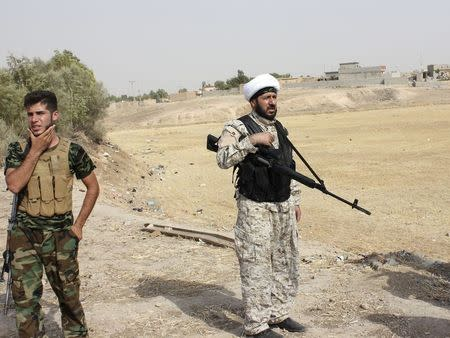 Armed tribal fighters take part in a mission to secure an area from militants of the Islamic State, formerly known as the Islamic State in Iraq and the Levant (ISIL), in the Hamrin mountains in Diyala province July 25, 2014. REUTERS/Stringer