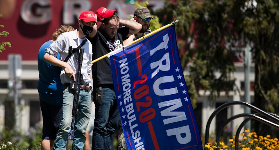 Voter advocates have expressed concern about armed Trump supporters seeking to intimidate voters. Source: Getty