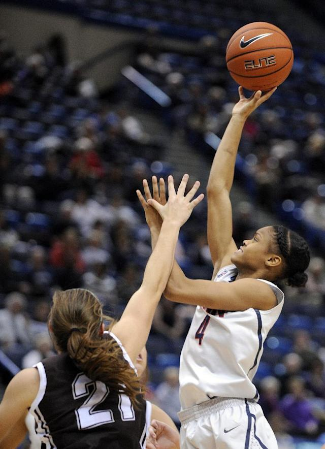 Connecticut's Moriah Jefferson (4) shoots over St. Bonaventure's Nyla Rueter (21) during the second half of Connecticut's 88-39 victory in an NCAA college basketball game in Hartford, Conn., on Sunday, Nov. 24, 2013. (AP Photo/Fred Beckham)