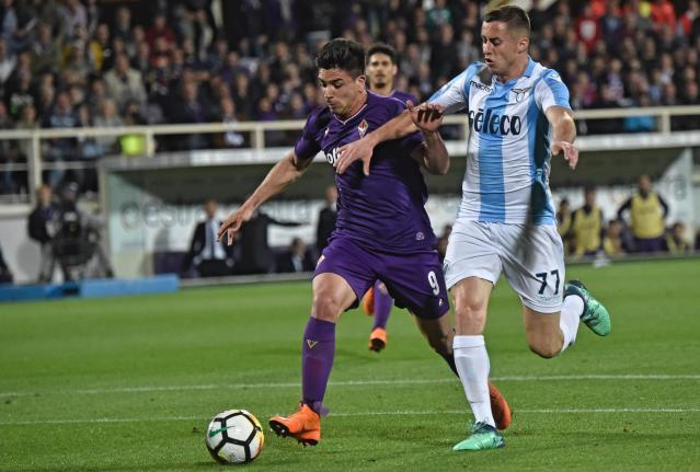 FILE - In this Wednesday, April 18, 2018. file photo, Fiorentina's Giovanni Simeone, left, and Lazio's Adam Marusic go for the ball during the Serie A soccer match between Fiorentina and Lazio at the Artemio Franchi stadium in Florence, Italy. Nearly 20 years after his father scuppered Juventus' title hopes, Giovanni Simeone has made it up to the Serie A club. Current Atletico Madrid coach Diego Simeone fired Lazio to a 1-0 win against Juventus in April 2000, with the capital club going on to finish a point above the Bianconeri to win the title. On Sunday, 18 years later, the younger Simeone netted a hat trick to help Fiorentina beat Juve's closest challengers Napoli 3-0 and leave the Bianconeri on the brink of a seventh successive title. (Maurizio Degl'Innocenti/ANSA via AP)