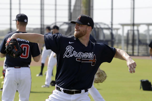 Newly acquired Atlanta Braves relief pitcher Will Smith throws during spring training baseball camp Thursday, Feb. 13, 2020, in North Port, Fla. (AP Photo/John Bazemore)