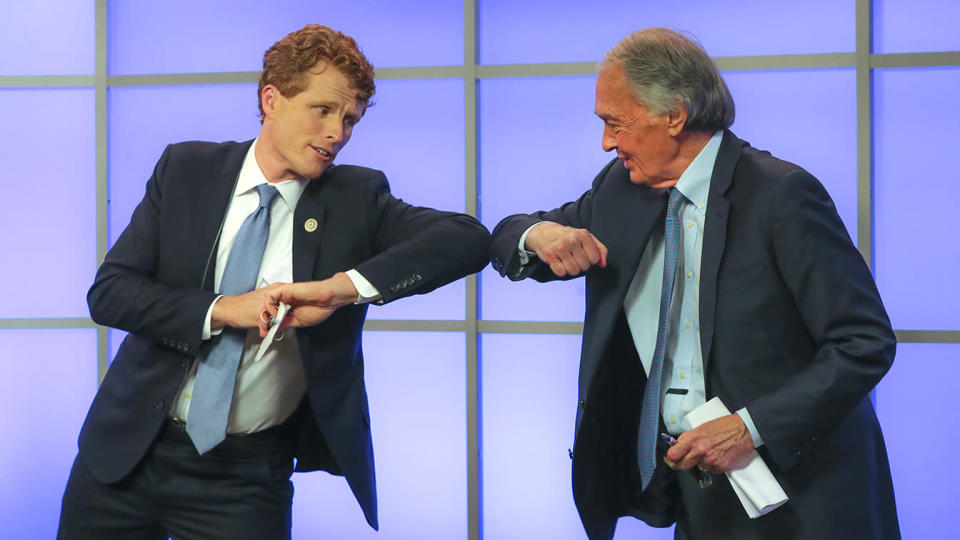Rep. Joseph P. Kennedy III elbow-bumps Sen. Edward J. Markey after their debate in Springfield, Mass., on June 1. (Matthew J. Lee/The Boston Globe via Getty Images)