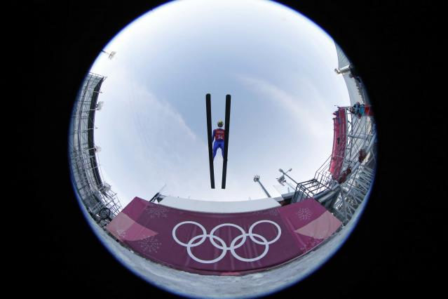 Nordic Combined Events - Pyeongchang 2018 Winter Olympics - Team LH Training - Alpensia Ski Jumping Centre - Pyeongchang, South Korea - February 21, 2018 - Bjoern Kircheisen of Germany trains. Picture taken with a fisheye lens. REUTERS/Jorge Silva