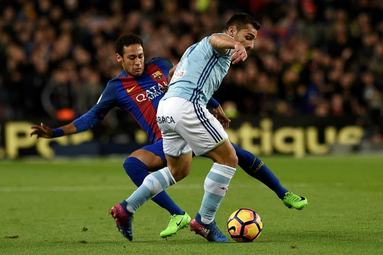 Barcelona's forward Neymar (L) vies with Celta Vigo's defender Jonny Castro during the Spanish league football match March 4, 2017