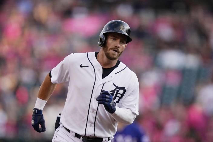 Detroit Tigers' Robbie Grossman rounds the bases after a solo home run off Texas Rangers starting pitcher Jordan Lyles during the first inning of a baseball game, Wednesday, July 21, 2021, in Detroit. (AP Photo/Carlos Osorio)