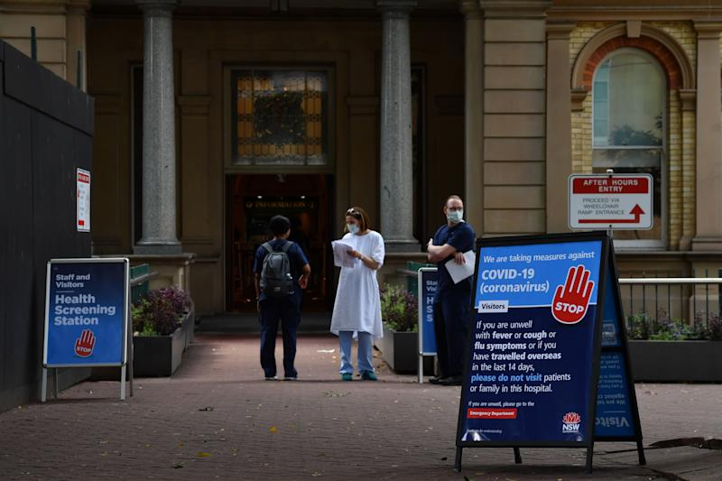 Staff wearing face masks outside the Royal Prince Alfred Hospital (RPA) in Camperdown, Sydney. Source: AAP