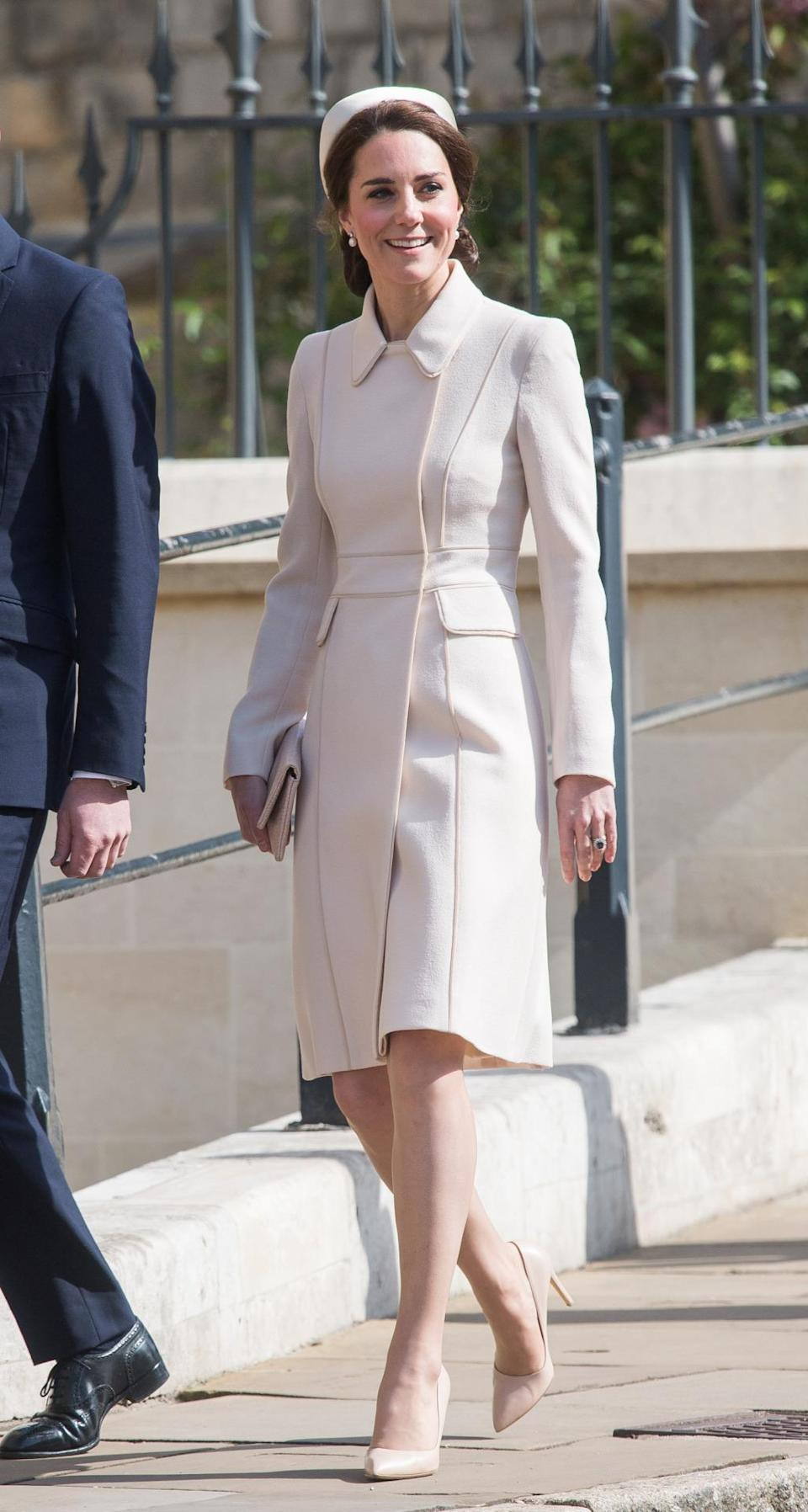 <p>Kate recycled yet another outfit for the Easter Sunday service in Windsor. Her bespoke cream coat by Catherine Walker was first seen on the Canadian royal tour. The Duchess chose matching accessories in the form of Rupert Sanderson pumps and a lattice clutch by Etui Bags. A satin pillbox hat topped off the springtime look. </p><p><i>[Photo: PA]</i></p>
