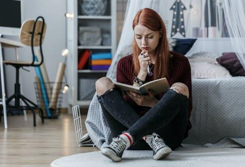 """<span class=""""attribution""""><a class=""""link rapid-noclick-resp"""" href=""""https://www.shutterstock.com/image-photo/redhead-girl-thinking-over-notebook-while-1014845614"""" rel=""""nofollow noopener"""" target=""""_blank"""" data-ylk=""""slk:Photographee.eu/Shutterstock"""">Photographee.eu/Shutterstock</a></span>"""