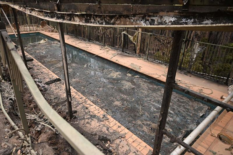 A swimming pool in the remains of a house, near Batemans Bay, destroyed by bushfires.