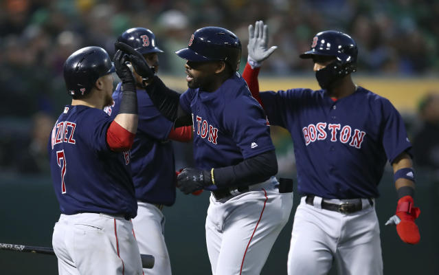 Boston Red Sox's Jackie Bradley Jr., center right, celebrates with Christian Vazquez (7) after hitting a three-run home run off Oakland Athletics' Kendall Graveman during the second inning of a baseball game Friday, April 20, 2018, in Oakland, Calif. (AP Photo/Ben Margot)