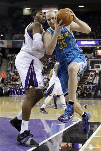 New Orleans Hornets center Chris Kaman (35) drives against Sacrament Kings forward Jason Thompson during the first quarter of an NBA basketball game in Sacramento, Calif., Wednesday, March 7, 2012. (AP Photo/Rich Pedroncelli)
