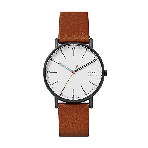 """<p><strong>Skagen</strong></p><p>amazon.com</p><p><strong>$95.00</strong></p><p><a href=""""https://www.amazon.com/dp/B06XMQH34J?tag=syn-yahoo-20&ascsubtag=%5Bartid%7C2139.g.36673991%5Bsrc%7Cyahoo-us"""" rel=""""nofollow noopener"""" target=""""_blank"""" data-ylk=""""slk:BUY IT HERE"""" class=""""link rapid-noclick-resp"""">BUY IT HERE</a></p><p>The watch equivalent of a Hans Wegner chair, this minimalist-meets-mid-century design is another great Scandinavian style option from Skagen. It comes with a 40mm stainless steel case, three-hand analog display, and a chic leather band. The tiny blue and orange accents make it stand out just enough. </p>"""