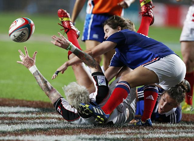 10ThingstoSeeSports - Canada's Jennifer Kish, left, on the ground, is tackled by France's Jade Le Pesq, right, during the final match of Women's Invitational Cup at the Hong Kong Sevens rugby tournament in Hong Kong, Friday, March 28, 2014. Canada won 24-0. (AP Photo/Kin Cheung, File)
