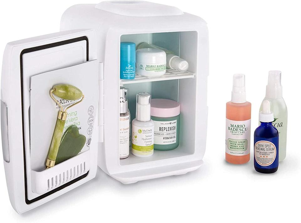 <p>If you're shopping for a skin-care fan, the <span>Cooluli Skincare Mini Fridge</span> ($50) is something you'll want to indulge in. They can store their vitamin C serums, sheet masks, facial massaging tools, and toners to give them an extra cooling feel.</p>