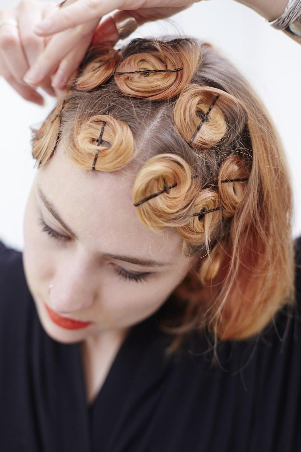 <p>Starting at the top of your head also makes it easier to create clean, uniform rolls.</p>