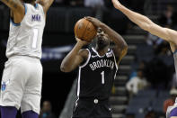 Brooklyn Nets' Theo Pinson (1) prepares to shoot as Charlotte Hornets' Malik Monk (1) defends during the first half of an NBA basketball game in Charlotte, N.C., Friday, Dec. 6, 2019. The Nets won 111-104. (AP Photo/Bob Leverone)