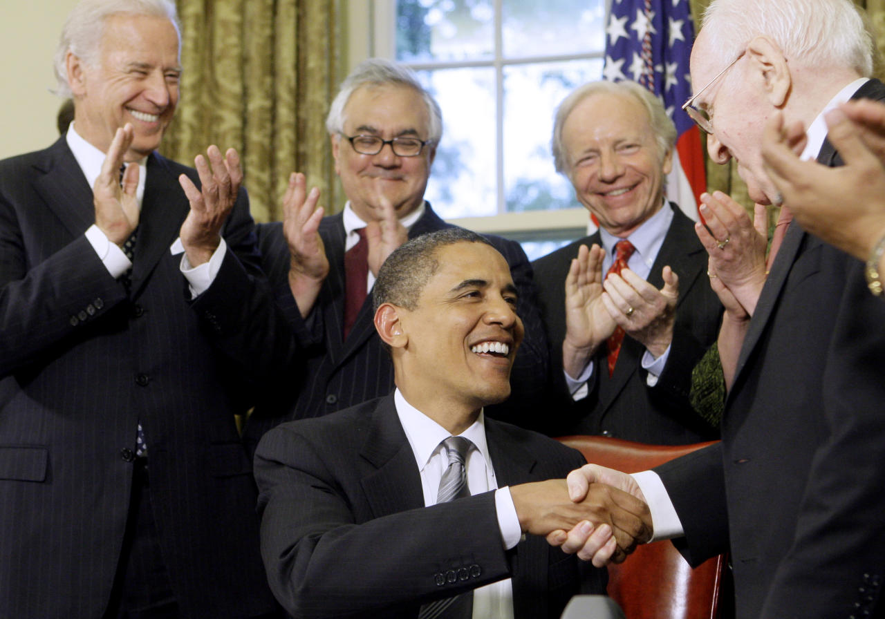 "FILE - In this June 17, 2009 file photo, President Barack Obama is congratulated by Franklin E. Kameny, right, after delivering brief remarks and signing a Presidential Memorandum regarding federal benefits and non-discrimination during a ceremony in the Oval Office of the White in Washington. Frank Kameny was out and proud before people knew what being ""gay"" meant. Fired from his job as a government astronomer in 1957 for being gay, he refused to go away quietly. Instead, he got louder. He took his case to the Supreme Court in 1961 and helped stage the first gay rights march in front of the White House and Philadelphia's Independence Hall in 1965. Kameny died Tuesday at the age of 86, leaving behind a 50-year legacy as an advocate who chipped away at countless other barriers for gay people in America. Kameny served as the initial protester, leader and legal strategist of what would become a movement, one historian said. Applauding from left are, Vice President Joe Biden, Rep. Barney Frank, D-Mass., and Sen. Joseph Lieberman, I-Conn. (AP Photo/Haraz N. Ghanbari, File)"
