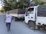 "In this Sunday, Jan. 3, 2021 photo provided by Medecins Sans Frontieres, a Medecins Sans Frontieres, worker supervises trucks being loaded with supplies in Mekele to be sent to other parts of the Tigray region in northern Ethiopia. From ""emaciated"" refugees to crops burned on the brink of harvest, starvation threatens the survivors of more than two months of fighting in Ethiopia's Tigray region. Authorities say more than 4.5 million people, or nearly the entire population, need emergency food. The first humanitarian workers to arrive after weeks of pleading with Ethiopia for access describe weakened children dying from diarrhea after drinking from rivers, and shops that were looted or depleted weeks ago. (Medecins Sans Frontieres via AP)"