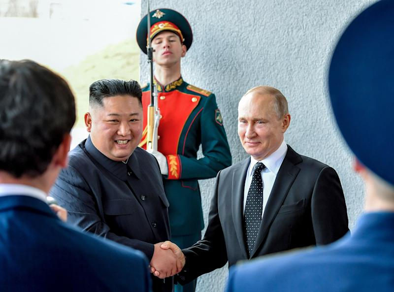 Russian President Vladimir Putin, center right, and North Korea's leader Kim Jong Un shake hands during their meeting in Vladivostok, Russia, Thursday, April 25, 2019. Putin and Kim are set to have a one-on-one meeting at the Far Eastern State University on the Russky Island across a bridge from Vladivostok. The meeting will be followed by broader talks involving officials from both sides. (Yuri Kadobnov/Pool Photo via AP)