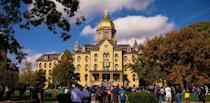 <p>Notre Dame University boasts an impressive 143 buildings on 1,250 acres just south of the Indiana Toll Road. The university's most distinguishable feature is the Golden dome atop the main building (the original burned down in 1879). The gold dome inspired the metallic helmets of the fighting Irish football team,which plays in the famous Notre Dame Stadium in front of more than 80,000 people on Game Day. </p>