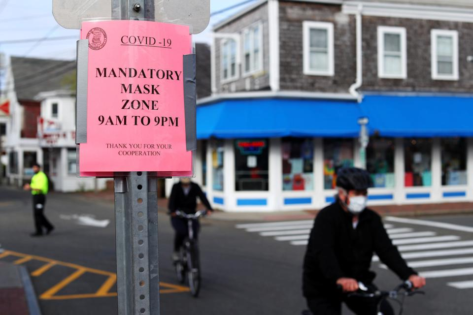 People bike down Commercial Street on May 25, 2020 in Provincetown, Massachusetts (Getty Images)