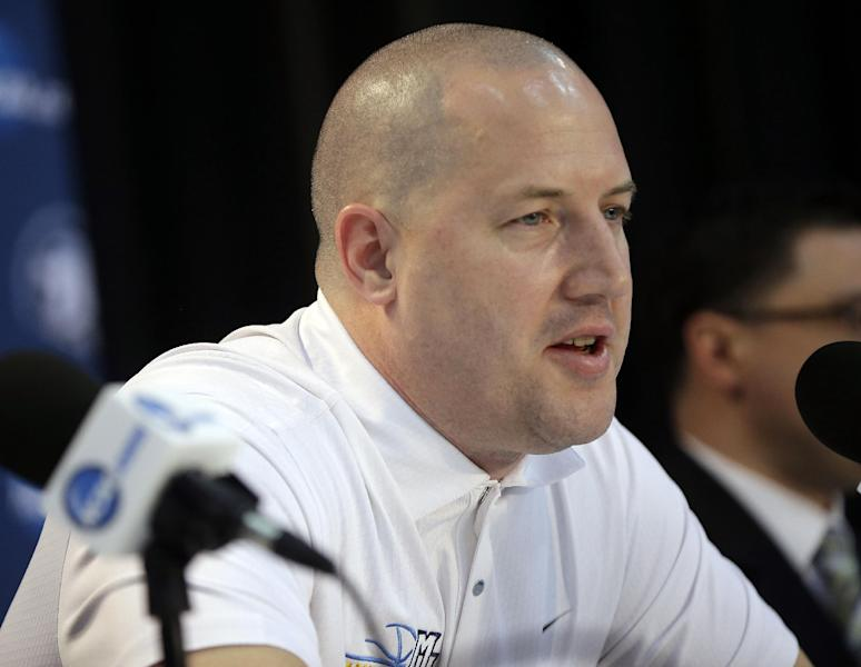 Marquette head coach Buzz Williams answer questions during a news conference Friday, March 29, 2013, in Washington. Marquette plays Syracuse in a regional semifinal game in the NCAA basketball tournament on Saturday. (AP Photo/Pablo Martinez Monsivais)