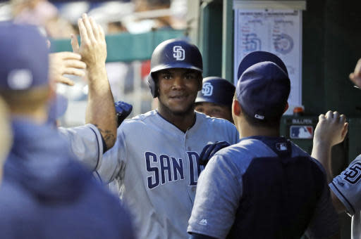 San Diego Padres' Franchy Cordero, center, is congratulated for his solo home run during the fourth inning of the team's baseball game against the Washington Nationals at Nationals Park, Tuesday, May 22, 2018, in Washington. (AP Photo/Alex Brandon)