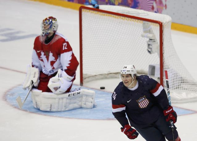 Team USA's Oshie reacts after scoring the game-winning shootout goal against Russia's goalie Bobrovski during their men's preliminary round ice hockey game at the 2014 Sochi Winter Olympics