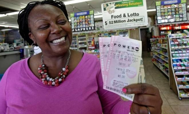 Felicia Ross flashes a winning smile in Orlando, Fla., while showing off Powerball tickets that probably won't win.
