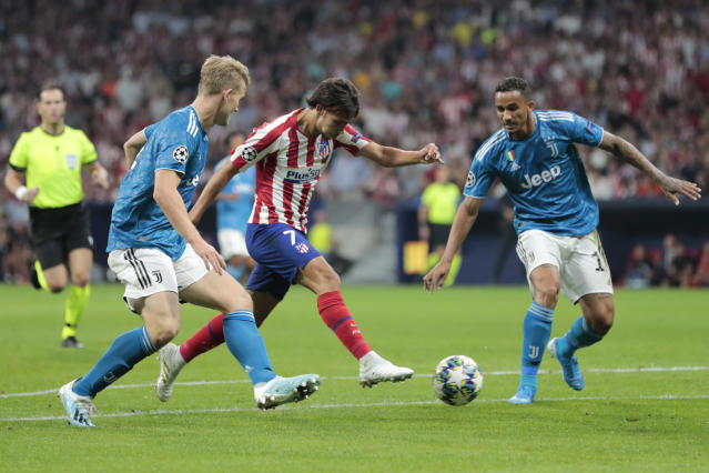Atletico Madrid's Joao Felix passes Juventus' Matthijs de Ligt, left, during the Champions League Group D soccer match between Atletico Madrid and Juventus at the Wanda Metropolitano stadium in Madrid, Spain, Wednesday, Sept. 18, 2019. (AP Photo/Bernat Armangue)