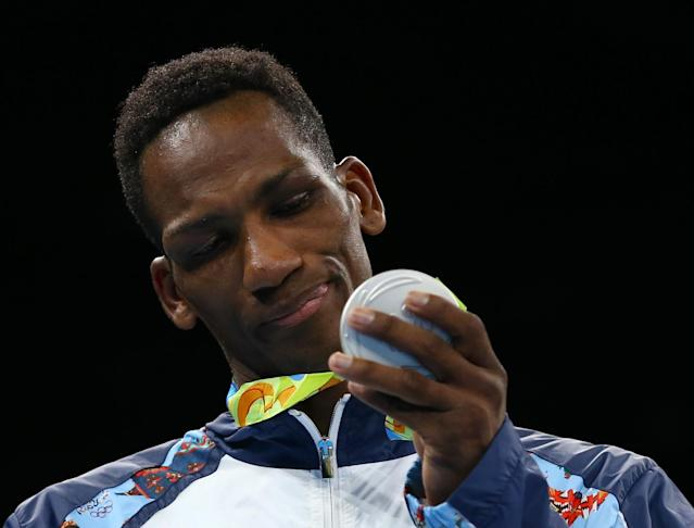 2016 Rio Olympics - Boxing - Victory Ceremony - Men's Light Welter (64kg) Victory Ceremony - Riocentro - Pavilion 6 - Rio de Janeiro, Brazil - 21/08/2016. Silver medallist Collazo Sotomayor (AZE) of Azerbaijan looks at his medal. REUTERS/Peter Cziborra TPX IMAGES OF THE DAY. FOR EDITORIAL USE ONLY. NOT FOR SALE FOR MARKETING OR ADVERTISING CAMPAIGNS.