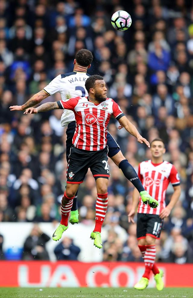 <p>Ryan Bertrand and Kyle Walker go up for a header </p>