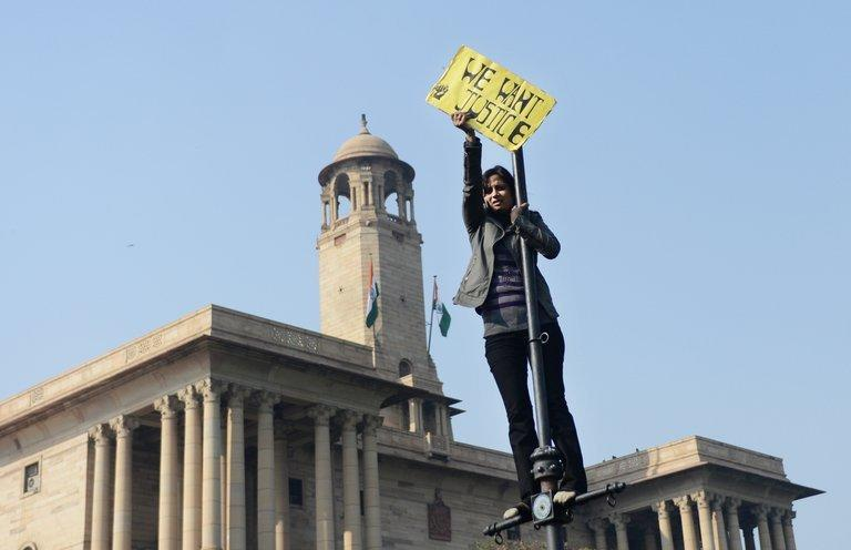 A demonstrator in front of the Government Secretariat and Presidential Palace in New Delhi on December 22, 2012. Thousands of protesters, most of them college students, rallied at the India Gate monument in the heart of the Indian capital and then surged toward the sprawling presidential palace