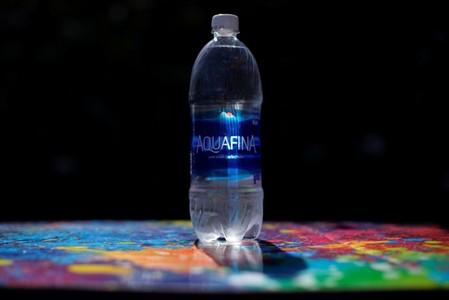 A bottle of Aquafina drinking water is shown in this photo illustration